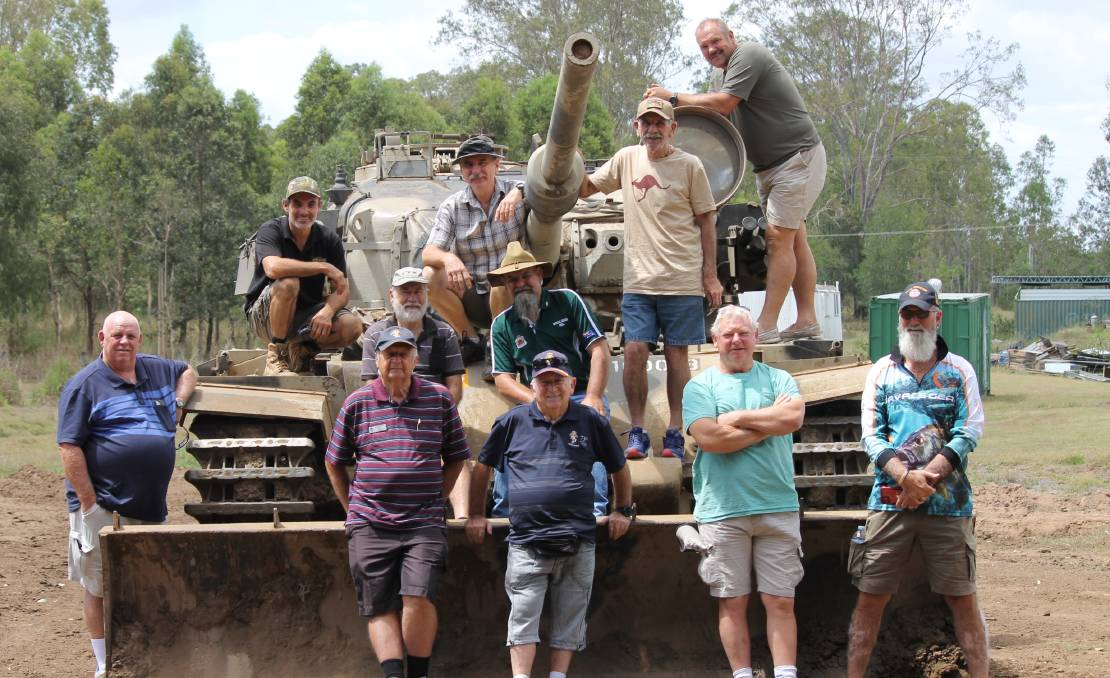 VETS: Members of the Scenic Rim Veterans Group on a working Centurion tank last year. Photo: Larraine Sathicq
